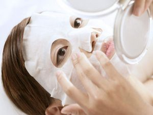 Chinese girl using facial mask